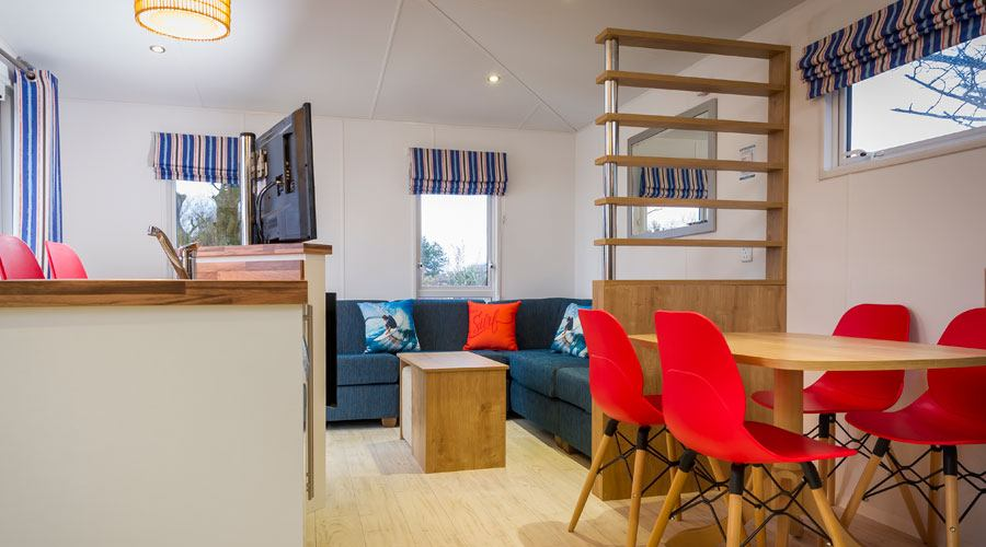 Azure caravan with decking in Surf Village