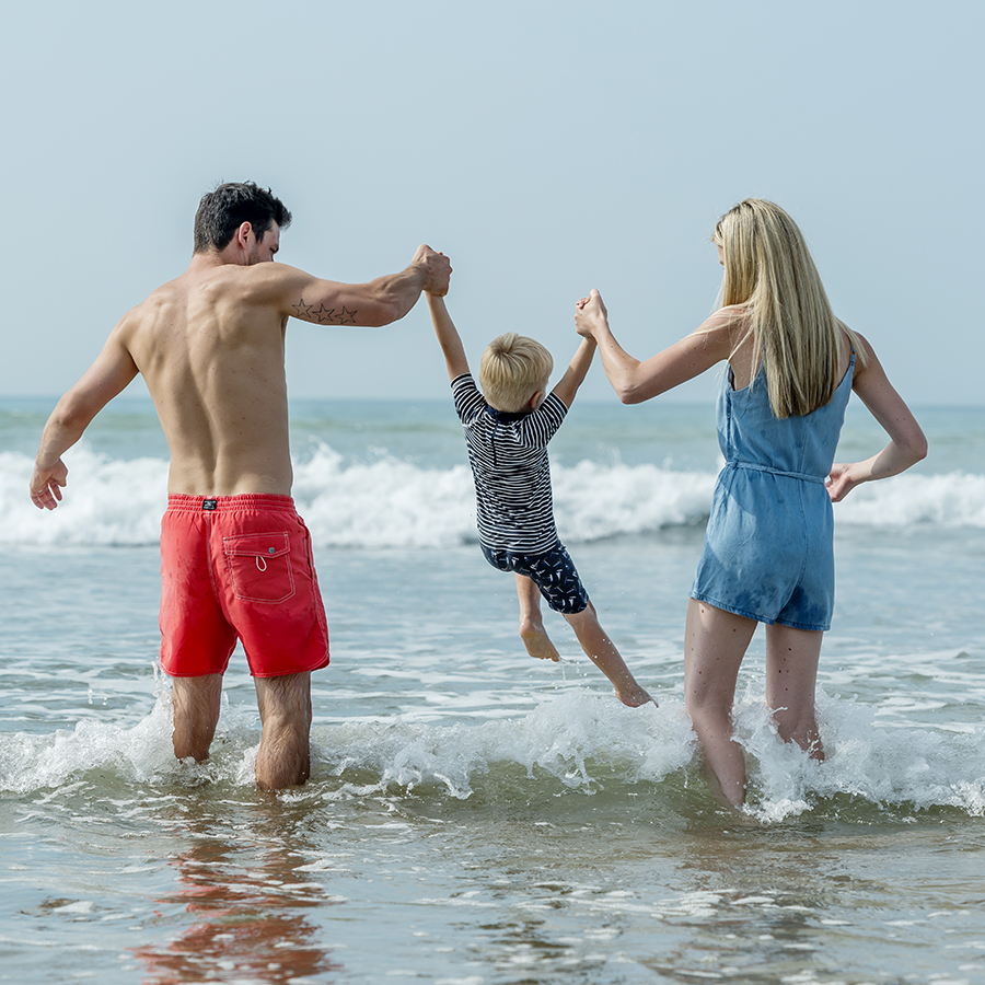 Young family on Woolacombe Beach