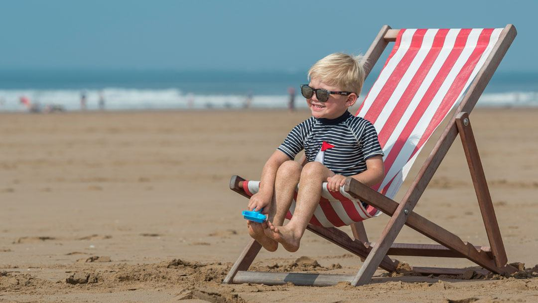 Boy on deckchair on Woolacombe Beach